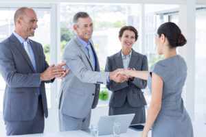 42578223 - interview panel shaking hands with applicant in the office